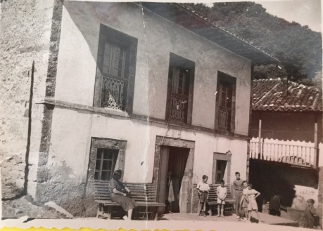 Grandma, as a child standing in front of the house in La Frecha
